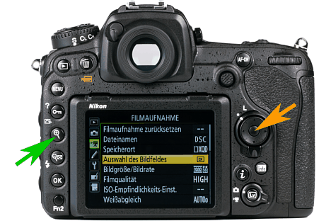 Bild Mit der Mitteltaste des Steuerkreuzes (oranger Pfeil) wird der Fokuspunkt bei der Nikon D5 und D500 im Live-View auf die Mitte gelegt. Mit der Lupentaste (grüner Pfeil) kann dieser Bereich zur visuellen Fokuskontrolle vergrößert werden. [Foto: MediaNord]
