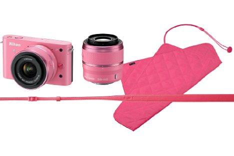 Bild Außer den Farben Schwarz, Weiß, Silber und Rot gab es die Nikon 1 J1 auch in Rosa, auch als Doppelzoom-Kit mit 10-30 mm und 30-110 mm. Die Objektive waren komplett in Rosa gehalten. Passend dazu gab es als Zubehör Einschlagtücher und Trageriemen. [Foto: Nikon]