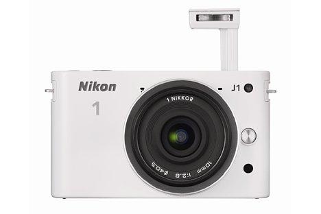 Bild Die stylische Nikon 1 J1 hatte, durchaus pfiffig, einen weit aus dem Kameragehäuse herausragen Pop-Up-Blitz. [Foto: Nikon]