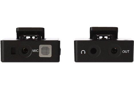 Bild Rollei Hear:Me Wireless - Transmitter (links) mit dem internen Mikrofon und dem Audio-Eingang und Receiver (rechts) mit dem Köpfhörer-Ausgang und daneben die Verbindung zur Kamera. [Foto: Rollei]