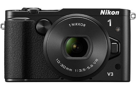 """Bild Mit der im April 2014 eingeführten Nikon 1 V3 stieg die Auflösung des CX-Format-Sensors auf 18 Megapixel ohne Tiefpassfilter. Elektronischer Sucher und Sucherhöcker verschwanden. Das Design wurde """"klassischer"""". [Foto: Nikon]"""