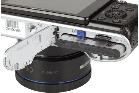 Bild Die Samsung NX3000 speichert ihre Bilder auf microSD-Karten. Ihr Akku liefert Energie für rund 370 Aufnahmen. [Foto: MediaNord]