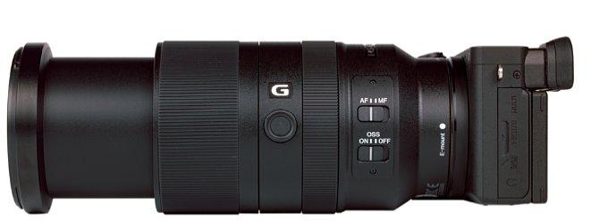 Bild Knapp fünf Zentimeter fährt das Sony E 70-350 mm 4.5-6.3 G OSS beim Zoomen aus. Bildstabilisator und Autofokus lassen sich bequem am Objektiv an- und ausschalten, zudem gibt es einen Funktionsknopf. [Foto: MediaNord]